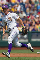 Louisiana State shortstop Alex Bregman (30) drops a ground ball against the North Carolina Tar Heels during Game 7 of the 2013 Men's College World Series on June 18, 2013 at TD Ameritrade Park in Omaha, Nebraska. The Tar Heels defeated the Tigers 4-2, eliminating LSU from the tournament. (Andrew Woolley/Four Seam Images)