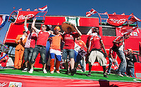 Denmark and Netherlands fans dance on a stage outside the stadium before their FIFA World Cup first round match between at Soccer City in Johannesburg, South Africa on Friday, June 11, 2010.