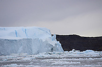 Large grounded Iceberg from Ilulissat glacier surrounded by drift ice. Disco Bay, Greenland