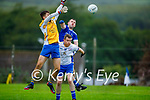 Mid air action as Keel keeper Cian Flynn takes to the air to clear his defence as team mate Barth Murphy keep a check on Killian Falvey of Annascaul in the Junior Premier football championship