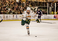 20 January 2017: University of Vermont Catamount Forward Matt Alvaro, a Freshman from Toronto, Ontario, winds up for a shot in the second period against the University of Connecticut Huskies at Gutterson Fieldhouse in Burlington, Vermont. The Catamounts held onto their lead throughout the game to defeat the Huskies 5-4 in Hockey East play. Mandatory Credit: Ed Wolfstein Photo *** RAW (NEF) Image File Available ***
