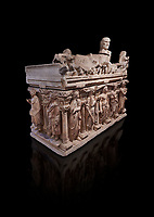 "Roman relief sculpted sarcophagus with kline couch lid with a reclining male figuer depicted, ""Columned Sarcophagi of Asia Minor"" style typical of Sidamara, 3rd Century AD, Konya Archaeological Museum, Turkey. Against a black background"
