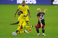 WASHINGTON, DC - OCTOBER 28: Fatai Alashe #26 of Columbus Crew SC battles for the ball with Erick Sorga #50 of D.C. United during a game between Columbus Crew and D.C. United at Audi Field on October 28, 2020 in Washington, DC.