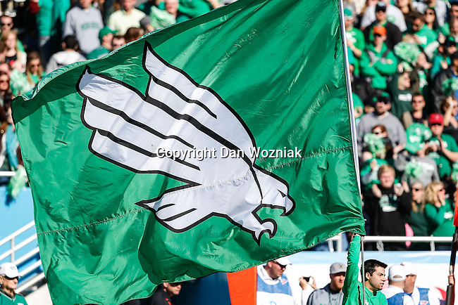 The North Texas Mean Green team flag gets run out onto the field during the Heart of Dallas Bowl game between the North Texas Mean Green and the UNLV Rebels at the Cotton Bowl Stadium in Dallas, Texas. UNT defeats UNLV 36 to 14.