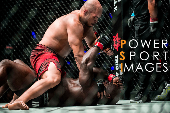 Alain Ngalani of Hong Kong vs Alexandre Machado of Brazil  in action during their flyweight bout as part of the One Championship on 13 August 2016 at The Venetian Macao Cotai Arena in Macau, China. Photo by Marcio Machado / Power Sport Images