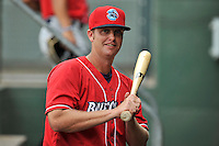 Manager Shawn Williams (22) of the Lakewood BlueClaws swings a bat in the dugout as his team prepares for a game against the Greenville Drive on Sunday, June 26, 2016, at Fluor Field at the West End in Greenville, South Carolina. Greenville won, 2-1. (Tom Priddy/Four Seam Images)