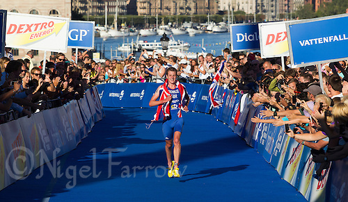 25 AUG 2013 - STOCKHOLM, SWE - Alistair Brownlee (GBR) of Great Britain wins the men's ITU 2013 World Triathlon Series round in Gamla Stan, Stockholm, Sweden (PHOTO COPYRIGHT © 2013 NIGEL FARROW, ALL RIGHTS RESERVED)