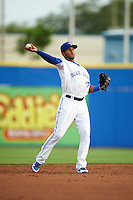 Dunedin Blue Jays shortstop Richard Urena (5) warmup throw to first during a game against the Palm Beach Cardinals on April 15, 2016 at Florida Auto Exchange Stadium in Dunedin, Florida.  Dunedin defeated Palm Beach 8-7.  (Mike Janes/Four Seam Images)
