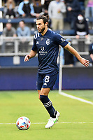 KANSAS CITY, KS - MAY 16: Graham Zusi #8 Sporting KC with the ball during a game between Vancouver Whitecaps and Sporting Kansas City at Children's Mercy Park on May 16, 2021 in Kansas City, Kansas.