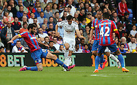 Pictured: Jack Cork of Swansea (C) is tackled by Mile Jedinak (L) of Crystal Palace (L)<br />