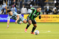 KANSAS CITY, KS - MAY 9: Cecilio Dominguez #10 Austin FC keeps the ball away from Roger Espinoza #15 Sporting KC during a game between Austin FC and Sporting Kansas City at Children's Mercy Park on May 9, 2021 in Kansas City, Kansas.