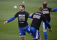 Gillingham players wear T-shirts ahead of kick-off with the words, Men taking action against violence towards women during Gillingham vs Exeter City, Emirates FA Cup Football at the MEMS Priestfield Stadium on 28th November 2020