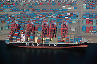 aerial photograph of a Hanjin containership docked at loading cranes in the Port of Long Beach, Los Angeles County, California