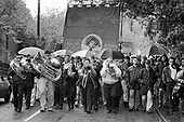 Brass band and an NUM banner lead a march marking the closure of Penallta colliery, South Wales