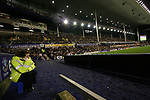Everton 1, West Ham United 2, 14/12/2005. Goodison Park, FA Premiership. A steward watching on from the side of the pitch as Everton host West Ham United in a mid-season game on Merseyside. The away team came from behind to win, watched by a crowd of 35,704. Photo by Colin McPherson.
