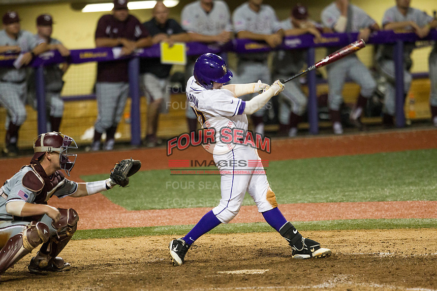 LSU Tigers infielder Danny Zardon (27) drives in the winning run during a Southeastern Conference baseball game against the Texas A&M Aggies on April 23, 2015 at Alex Box Stadium in Baton Rouge, Louisiana. LSU defeated Texas A&M 4-3. (Andrew Woolley/Four Seam Images)