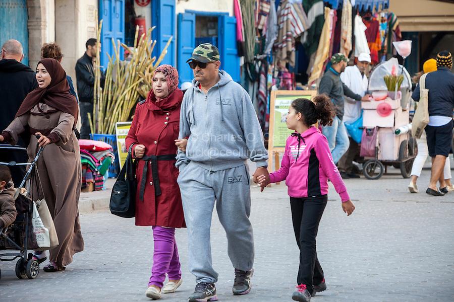Essaouira, Morocco.  Family Walking in Avenue de l'Istiqlal.