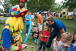Korndog the clown makes balloons for kids during the NV150 Fair at Fuji Park in Carson City, Nev., on Sunday, August 3, 2014.<br /> (Photo By Kevin Clifford)