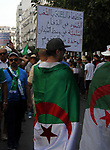 Algerian protesters march in an anti-government demonstration in the capital Algiers on July 26, 2019.  Photo by Taher Boussoualim
