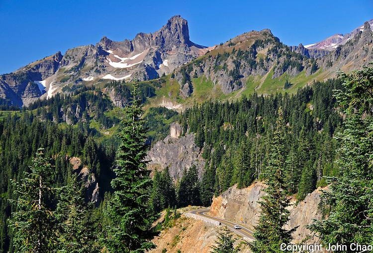 Highway 410 passes through rugged mountain terrain below the Cowlitz Chimneys, Mount Rainier National Park, Washington State.