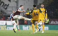 Brighton & Hove Albion's Leon Balogun is tackled by Burnley's Ashley Barnes<br /> <br /> Photographer Rich Linley/CameraSport<br /> <br /> The Premier League - Burnley v Brighton and Hove Albion - Saturday 8th December 2018 - Turf Moor - Burnley<br /> <br /> World Copyright © 2018 CameraSport. All rights reserved. 43 Linden Ave. Countesthorpe. Leicester. England. LE8 5PG - Tel: +44 (0) 116 277 4147 - admin@camerasport.com - www.camerasport.com