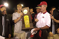 Arkansas Democrat-Gazette/MICHAEL WOODS<br /> <br /> University of Arkansas track and field's Alistair Cragg, Daniel Lincoln and coach John McDonnell clelbrates with his team after winning the Mens 2003 NCAA Division 1 Track and Field Championship Saturday evening's in Sacramento.   <br /> <br /> 6/15/03