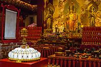 Buddha Tooth Relic Temple Main Prayer Hall.  Buddha Maitreya Flanked by Two Bodhisattvas.  Buddha Displaying the Abhaya Mudra, the Gesture Dispelling Fear.