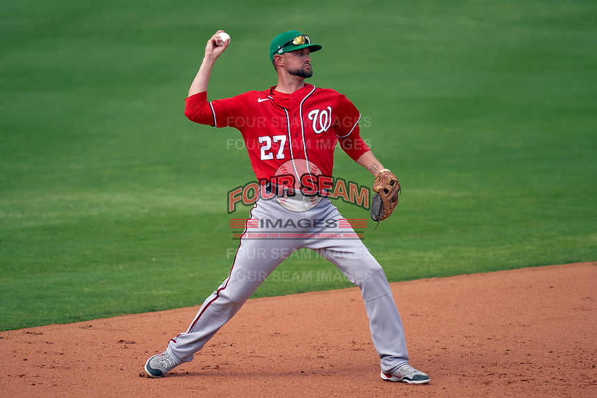 Washington Nationals third baseman Jordy Mercer (27) throws to first base during a Major League Spring Training game against the New York Mets on March 18, 2021 at Clover Park in St. Lucie, Florida.  (Mike Janes/Four Seam Images)