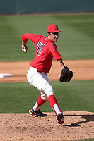 Ian Churchill (34) of the Arizona Wildcats pitches against the UCLA Bruins at Jackie Robinson Stadium on March 20, 2021 in Los Angeles, California. Arizona defeated UCLA, 7-3. (Larry Goren/Four Seam Images)