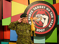Air Farce star Don Ferguson and the show's Chicken Cannon that will be fired on the annual Air Farce New Year's Eve Special on Dec 31, at 8pm on CBC Television. (CNW Group/Air Farce Productions Inc.)
