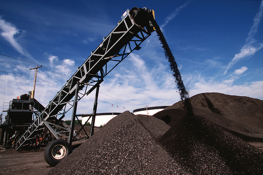 Recycled roadmix asphalt processing plant used to pave new roads and repair.