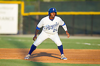 Alex Newman (24) of the Burlington Royals takes his lead off of first base against the Princeton Rays at Burlington Athletic Park on July 11, 2014 in Burlington, North Carolina.  The Rays defeated the Royals 5-3.  (Brian Westerholt/Four Seam Images)