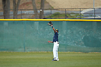 Wingate Bulldogs center fielder Justin Guy (1) settles under a fly ball during the game against the Concord Mountain Lions at Ron Christopher Stadium on February 1, 2020 in Wingate, North Carolina. The Bulldogs defeated the Mountain Lions 8-0 in game one of a doubleheader. (Brian Westerholt/Four Seam Images)