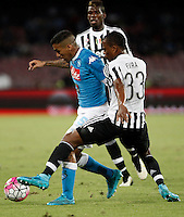 Calcio, Serie A: Napoli vs Juventus. Napoli, stadio San Paolo, 26 settembre 2015. <br /> Napoli's Marques Allan, left, is challenged by Juventus' Patrice Evra during the Italian Serie A football match between Napoli and Juventus at Naple's San Paolo stadium, 26 September 2015.<br /> UPDATE IMAGES PRESS/Isabella Bonotto