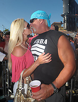 MIAMI - FL  - MARCH 15;  Hulk Hogan (AKA Terry Gene Bollea) along with girlfriend Jennifer McDaniel show support for daughter Brooke Hogans performace at the Calle Ocho carnival. The Hulk was seen with on crutches after he was injured at the court house fighting with his x wifes lawyer. the hulk also had only one crutch after the other was was stolen from him at the airport. the Hulk spent time kissing his girlfriend in between songs  On March 15, 2009 in Miami Florida.<br /> <br /> People:  Hulk Hogan, Jennifer McDaniel