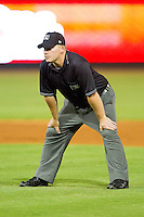 Umpire Garrett Corl handles the calls on the bases during the Carolina League game between the Frederick Keys and the Winston-Salem Dash at BB&T Ballpark on May 29, 2012 in Winston-Salem, North Carolina.  The Dash defeated the Keys 8-7.  (Brian Westerholt/Four Seam Images)
