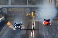 Feb. 23, 2013; Chandler, AZ, USA; NHRA funny car driver Matt Hagan (left) alongside Johnny Gray during qualifying for the Arizona Nationals at Firebird International Raceway. Mandatory Credit: Mark J. Rebilas-