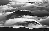 """Clouds roll over cinder cones in Haleakala """"Crater"""" in Haleakala National Park, Maui."""