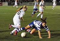 AA Gent dames - Club Brugge dames :<br /> Evy De Smedt (R) gaat neer bij een duel met Silke Demeyere (L)<br /> foto Dirk / Nikonpro.be