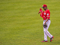 27 July 2013: Washington Nationals pitcher Rafael Soriano untucks his jersey after closing out a game against the New York Mets at Nationals Park in Washington, DC. The Nationals defeated the Mets 4-1. Mandatory Credit: Ed Wolfstein Photo *** RAW (NEF) Image File Available ***