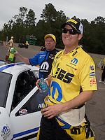 Mar. 17, 2013; Gainesville, FL, USA; NHRA runner-up, Jeg Coughlin congratulates pro stock driver Allen Johnson celebrates after winning the Gatornationals at Auto-Plus Raceway at Gainesville. Mandatory Credit: Mark J. Rebilas-