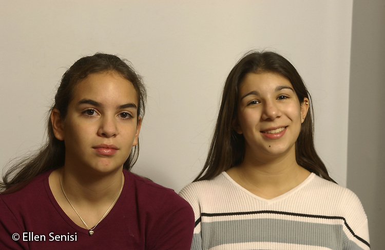 MR / Schenectady, NY.Sisters, aged 15, 12..Non-biological sisters of Hispanic and Native American ancestry adopted from Columbia at birth by suburban Caucasian family..MR: She4 She5.©Ellen B. Senisi