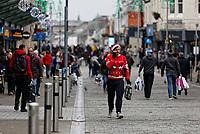 A last minute Christmas shopper in festive wear in Oxford Street, Swansea, Wales, UK. Monday 24 December 2018