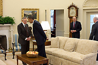President Barack Obama talks with Senate Majority Leader Harry Reid following their meeting with House Speaker Nancy Pelosi in the Oval Office, Oct. 7, 2009. (Official White House Photo by Pete Souza)<br /> <br /> This official White House photograph is being made available only for publication by news organizations and/or for personal use printing by the subject(s) of the photograph. The photograph may not be manipulated in any way and may not be used in commercial or political materials, advertisements, emails, products, promotions that in any way suggests approval or endorsement of the President, the First Family, or the White House.