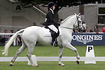 August 08, 2009: Competitor 703 in the dressage class for ponies . Land Rover International Puissance. Failte Ireland Horse Show. The RDS, Dublin, Ireland.