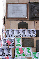 Statue on the main street of General San Martin on horseback, horse equestrian. posters glued to the stone pedestal asking for help to find a lost person Neuquen, Patagonia, Argentina, South America