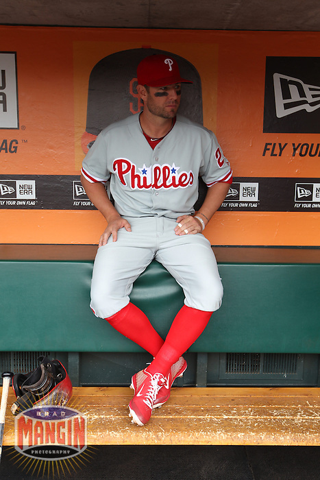 SAN FRANCISCO, CA - MAY 8:  Kevin Frandsen #28 of the Philadelphia Phillies gets ready in the dugout before the game against the San Francisco Giants at AT&T Park on Wednesday, May 8, 2013 in San Francisco, California. Photo by Brad Mangin