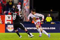 Heath Pearce (3) of the New York Red Bulls and Nick DeLeon (18) of D. C. United. D. C. United defeated the New York Red Bulls 1-0 (2-1 in aggregate) during the second leg of the MLS Eastern Conference Semifinals at Red Bull Arena in Harrison, NJ, on November 8, 2012.
