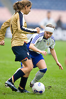 Essi Sainio of Finland and Tobin Heath of the USA. The U.S. defeated Finland, 4-1 during the Four Nations Tournament in  Guangzhou, China on January 18, 2008.