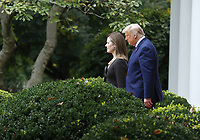 US President Donald J. Trump arrives with Judge Amy Coney Barrett (L) as his nominee to be an Associate Justice of the Supreme Court during a ceremony in the Rose Garden of the White House in Washington, DC, USA, 26 September 2020. Judge Barrett, if confirmed, will replace the late Justice Ruth Bader Ginsburg.<br /> CAP/MPI/RS<br /> ©RS/MPI/Capital Pictures